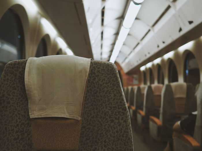 Empty seats in illuminated airplane
