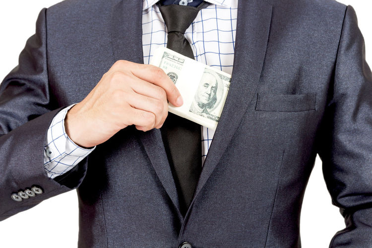 Midsection Of Businessman With Paper Currency Against White Background