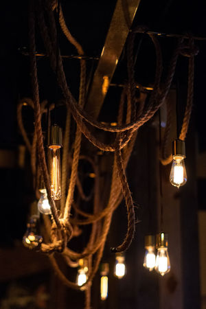 Ropes and Lights Illuminated Light Bulbs Ropes Decoration Hanging Light Pendant Pendant Light Vintage Style Vintage Lights Ceiling Lights Design Lighting Lighting Decoration Restaurant Lights Low Light Christmas Decoration Black Background Hanging Celebration Holiday - Event Close-up Chandelier Electric Bulb Christmas Market Christmas Lights Representing