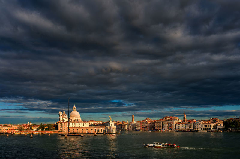 High angle view of grand canal by buildings against cloudy sky