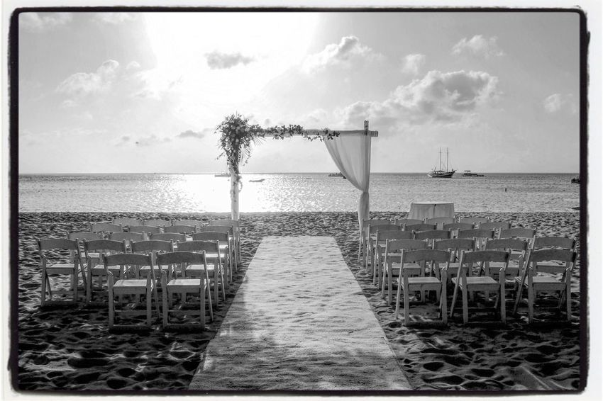 The couple comes forth. Vows are declared and then affirmed. The next chapter of their lives begins. Marriage  Caribbean Island Wedding Weddings Around The World Wedding Photography Wedding Aruba Sea Water Horizon Over Water Beach Sky Sand Nature Cloud - Sky Outdoors Beauty In Nature Vacations