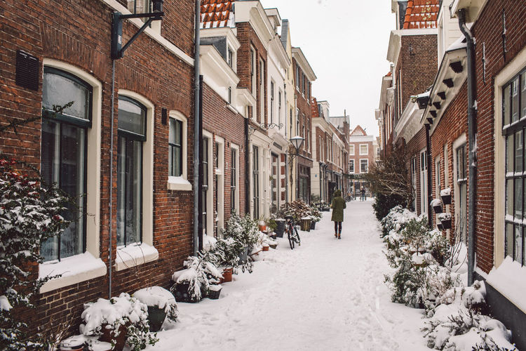 Street amidst buildings during winter