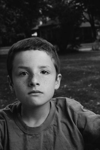 Close-up portrait of boy at park