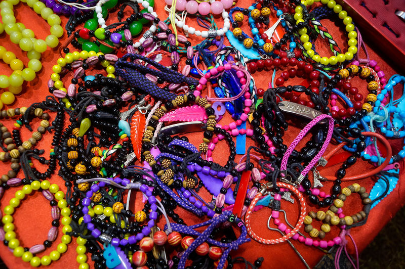 High angle view of multi colored jewelry for sale at market