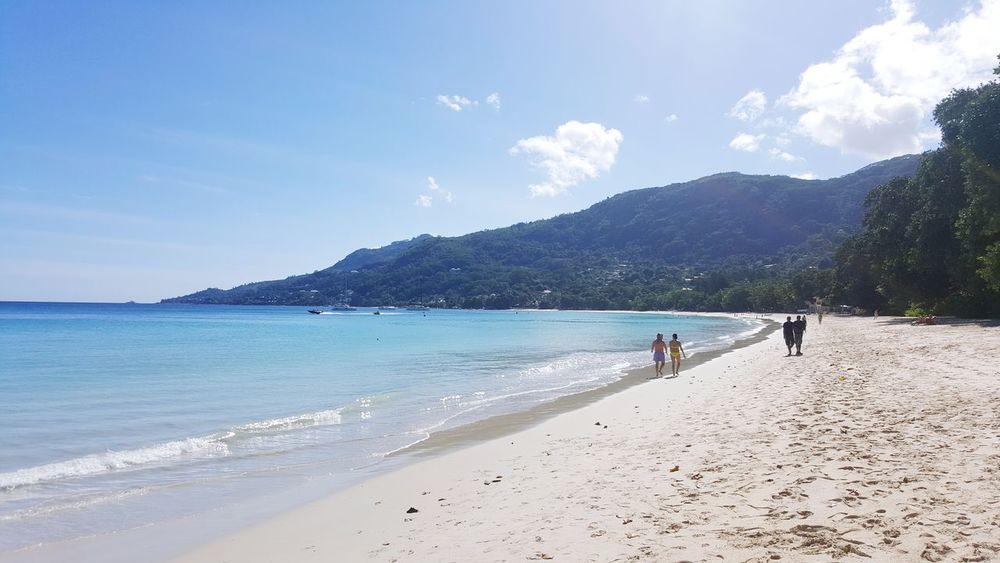 Beach Sand Sea Vacations Sunny Summer People Nature Blue Sky Travel Destinations Beauty In Nature Scenics Island Paradise Seychelles Islands Seychelles Ocean Tourist Freshness Outdoors EyeEm Selects Sunlight