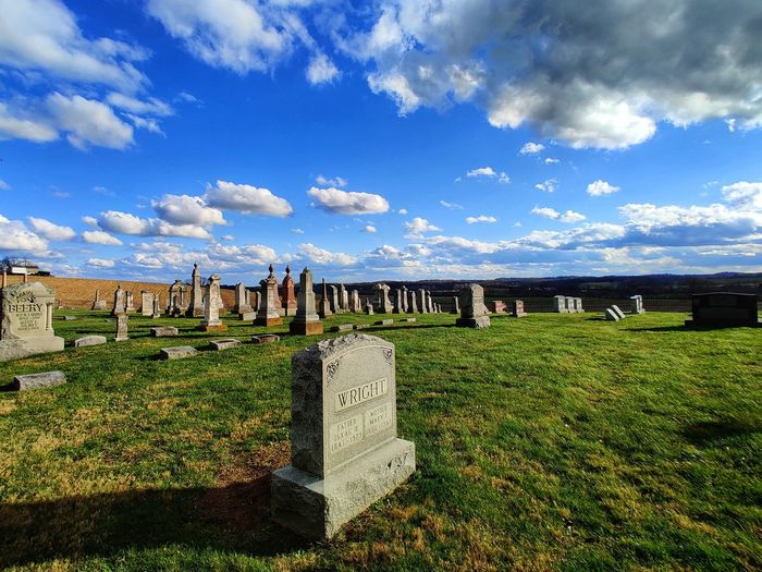 View of cemetery against cloudy sky
