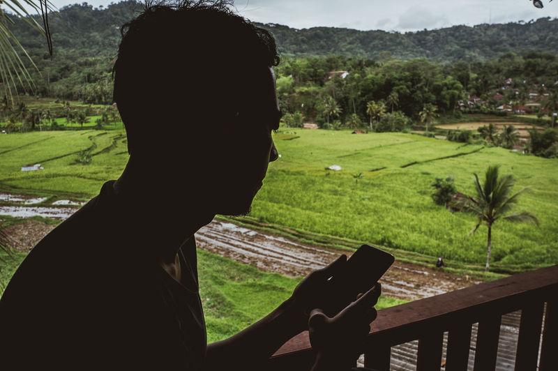 Portrait of man on field