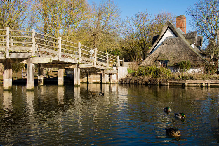 Flatford Bridge Cottage on the River Stour. Flatfordbridge Water Built Structure Architecture Bridge Cottage River Riverside Ducks Water Reflections Water_collection Winter Wintertime Blue Sky