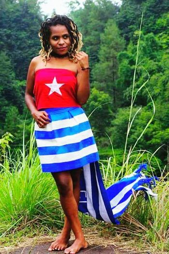 One Person Looking At Camera Outdoors Only Women Tree Nature Women West Papua People West Papua Flag West Papua Politic Of Freedom Human Body Part One Woman Only Countrylife West Papua Culture West Papua Tradition Uniform Of West Papua Tradition Arts Culture And Entertainment Politics Patriotism West Papua Girl West Papua Women Ideology Childhood Young Women Standing