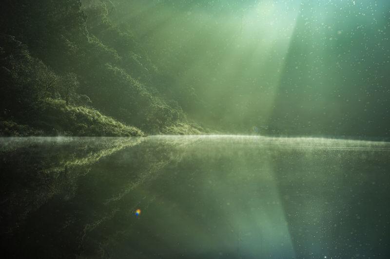 Sunlight streaming through lake