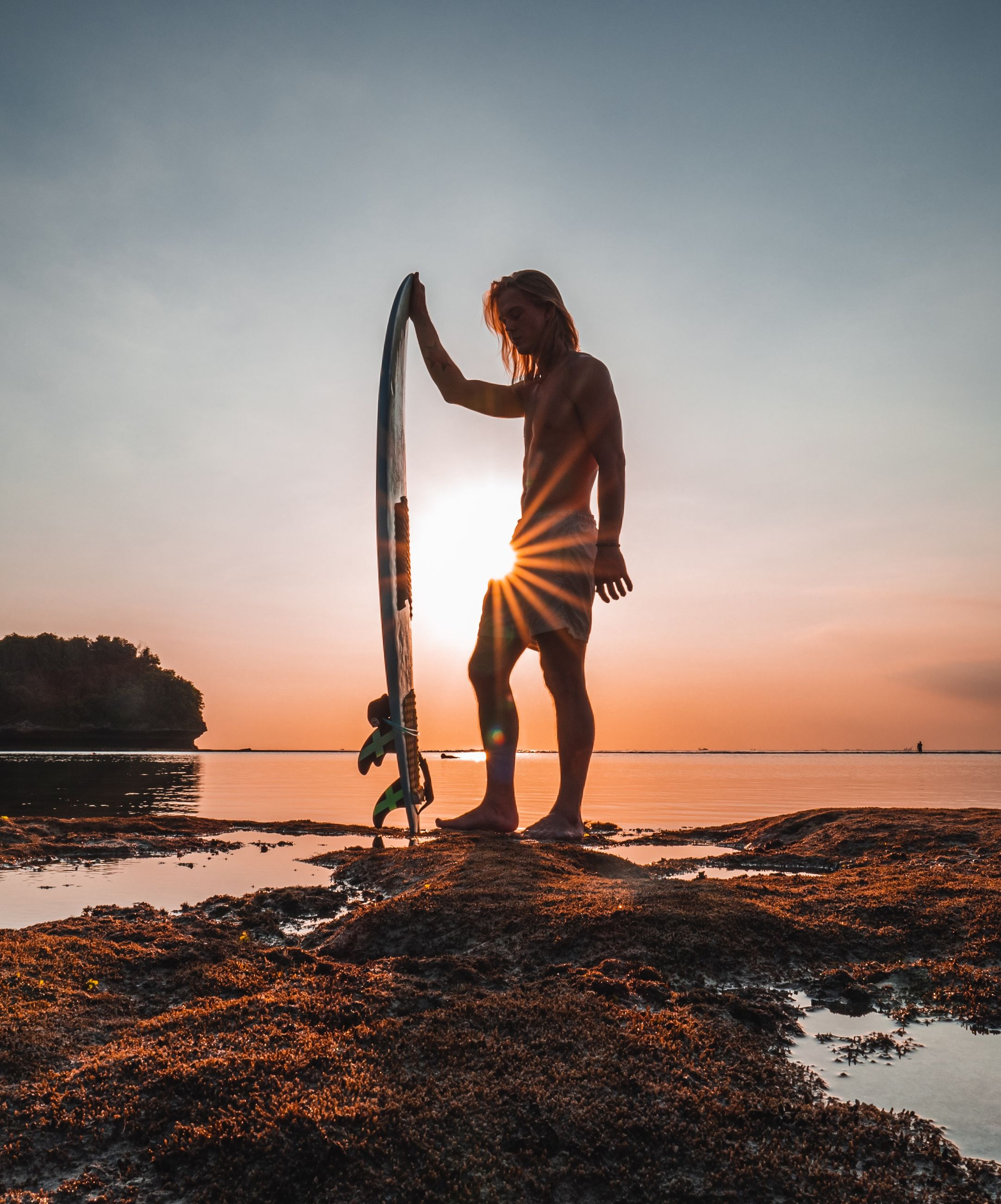 sky, sunset, water, sea, real people, beach, one person, beauty in nature, scenics - nature, land, leisure activity, nature, lifestyles, orange color, full length, standing, horizon over water, rock, outdoors