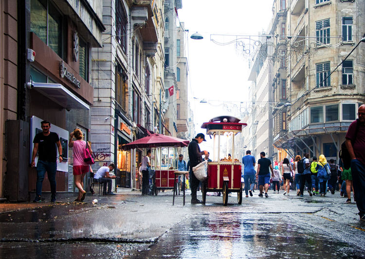 Rain Rainy Days Adult Architecture Building Exterior Built Structure City Day Large Group Of People Lifestyles Men Outdoors People Real People Sky Street Street Photography Streetphotography Taksim Walking Women
