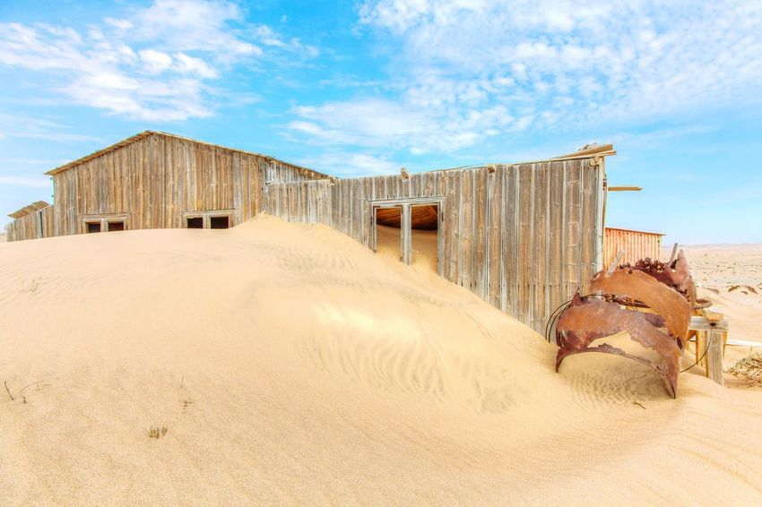 Traveling Travel Cloud - Sky Sky Built Structure Sand Architecture Building Exterior Day Outdoors No People Domestic Animals Desert Sand Dune Corrugated Iron Nature Lostplaces Abandoned Places Namibia Sand Dunes Lost Place