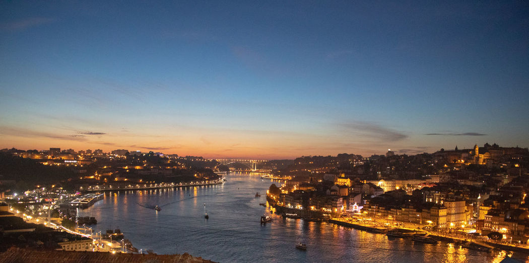 Porto night shot of Douro river with views of Gaia and Ribeira districts Douro  Porto Portugal Architecture Building Building Exterior Built Structure City Cityscape Copy Space High Angle View Illuminated Nature Nautical Vessel Night No People Outdoors Reflection River Sky Sunset Transportation Water