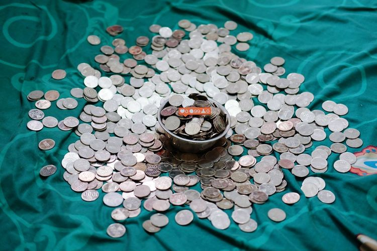 High angle view of coins on floor