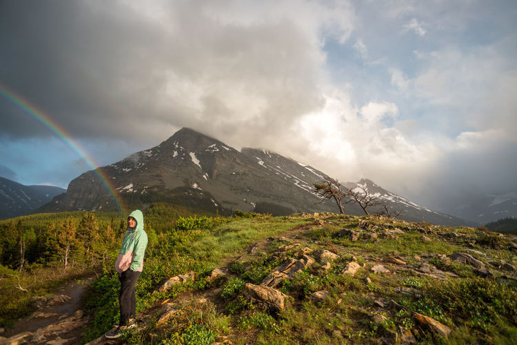 Glacier National Park Mountain Cloud - Sky Scenics - Nature Sky One Person Beauty In Nature Full Length Mountain Range Adventure Standing Nature Leisure Activity Non-urban Scene Tranquility Tranquil Scene Landscape Environment Day Outdoors Looking At View Glacier Nature Montana Rainbow Hiking