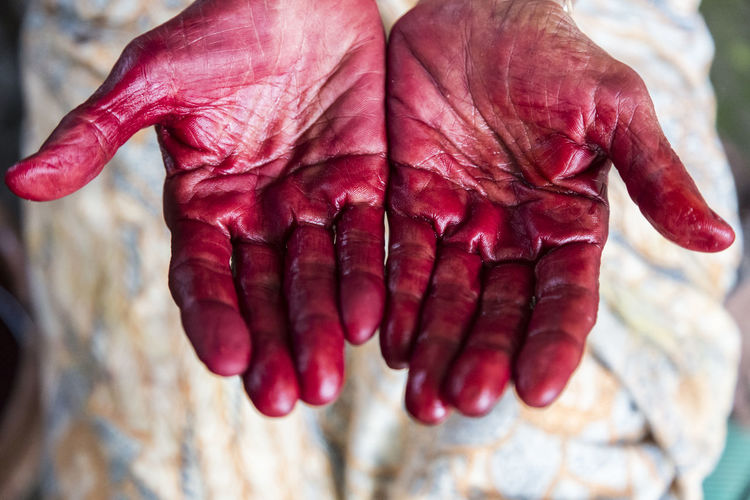 Cropped Image Of Red Messy Hands