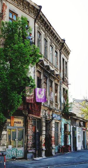 Architecture Building Exterior Built Structure Outdoors Façade History Sky Low Angle View Tree Clear Sky Day City Gipsy Old Buildings Carpet Mahalo Architecture Bucharest People Watching The Secret Spaces Street Art/Graffiti Resist! EyeEm Diversity Resist
