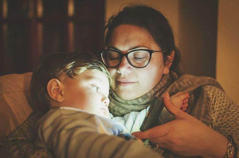 Mobile Conversations Family Mother Eyeglasses  Child Real People Portrait Indoors  Close-up People Family With One Child The Portraitist - 2017 EyeEm Awards This Is Family International Women's Day 2019