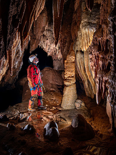 Full length of man standing in cave