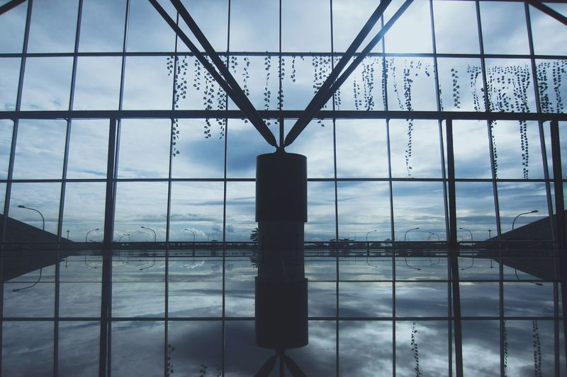 Fresh On Eyeem  Airport Low Angle View Airport Photography Symmetry Indoors  My Year My View Reflection Airport Life Sillouettes Geometric Shapes Travel Kualanamu Airport Medan INDONESIA Abstract Sky Cloud - Sky Day Architecture Built Structure No People