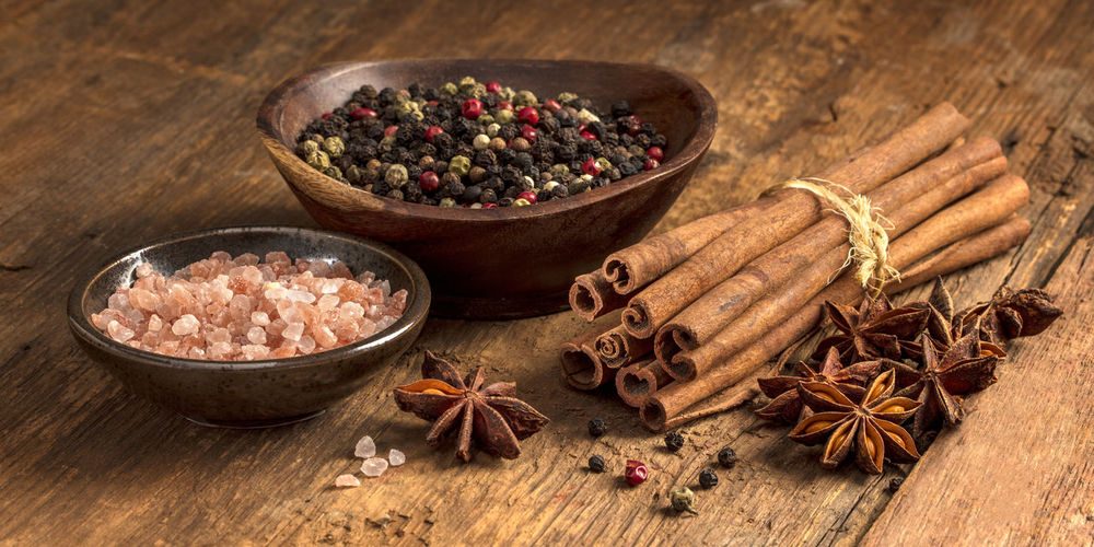 Close-up of spices -salt, pepper, anise, cinnamon