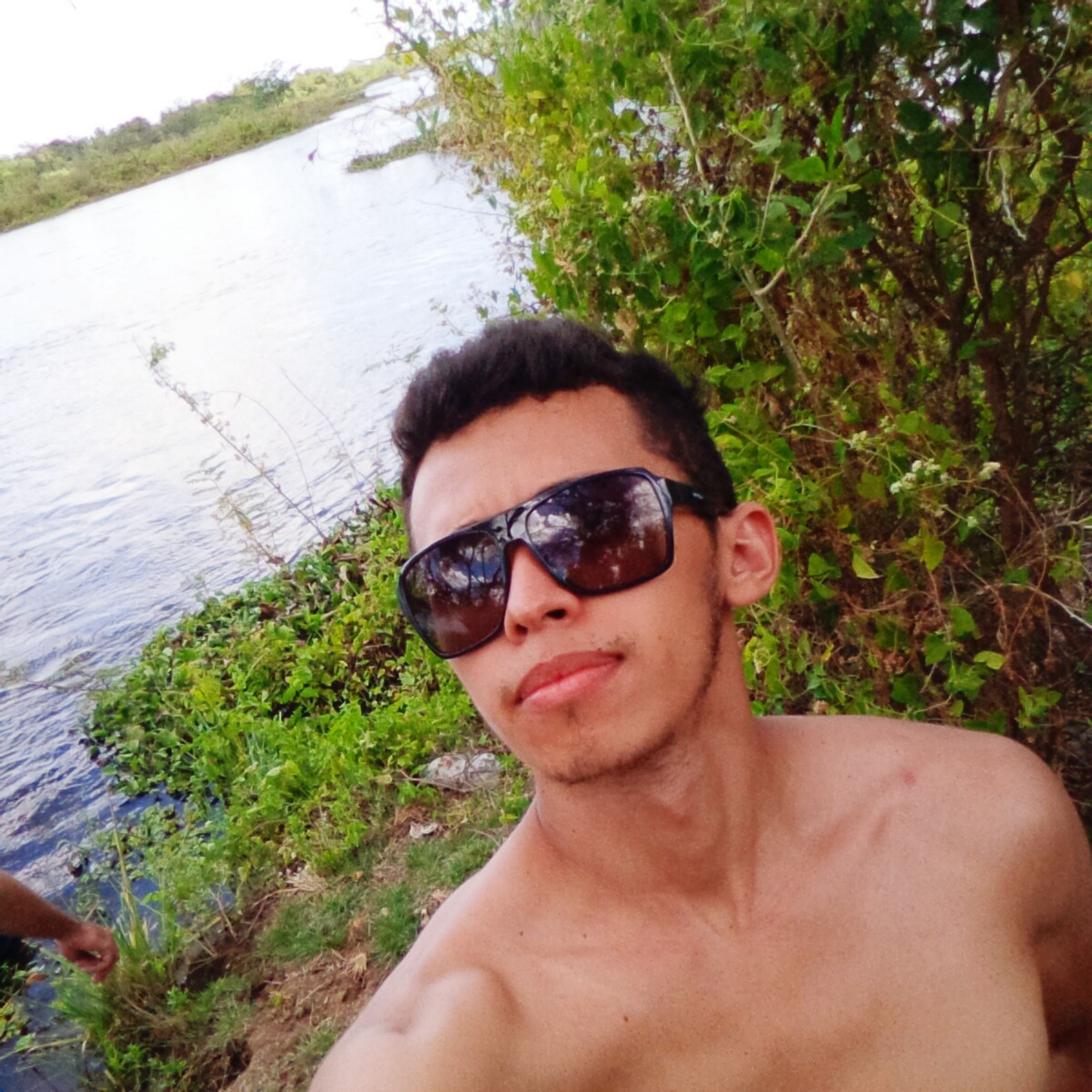 young adult, lifestyles, portrait, leisure activity, looking at camera, person, water, sunglasses, young men, headshot, front view, tree, vacations, lake, day, sunlight, nature