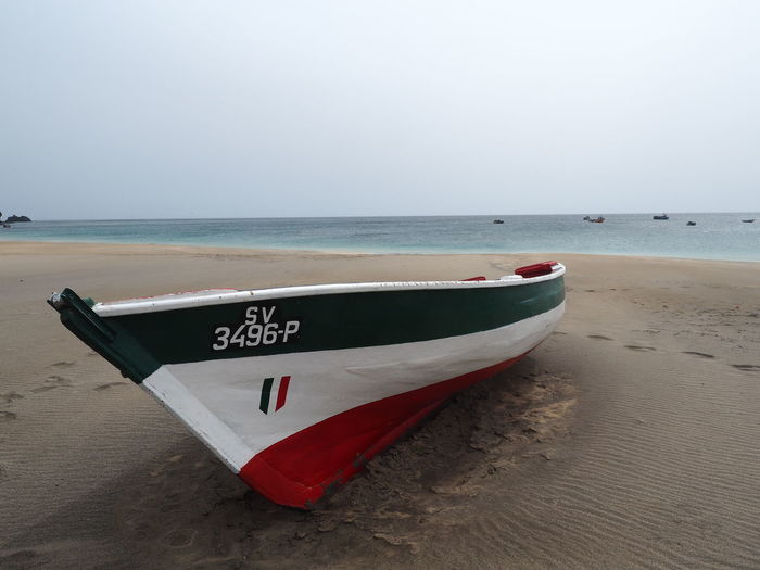 Beach Beauty In Nature Day Horizon Over Water Longtail Boat Mode Of Transport Moored Nature Nautical Vessel No People Outdoors Sand Scenics Sea Shore Sky Text Transportation Water