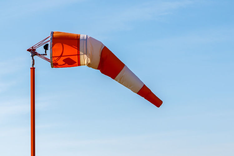 Low angle view of windsock against clear sky