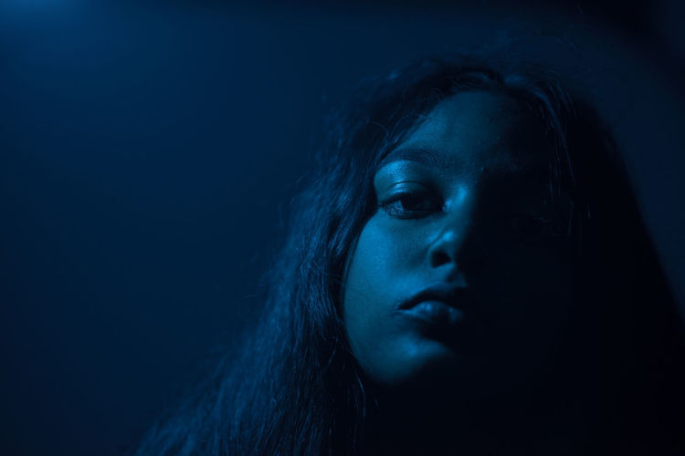 Blue Ivy Portrait Headshot Studio Shot Dark Indoors  One Person Women Close-up Looking Hair Black Background Body Part Human Face Human Body Part Blue Adult Young Adult Long Hair Emotion Blue Background Hairstyle Contemplation Beautiful Woman Depression - Sadness Human Hair Capture Tomorrow