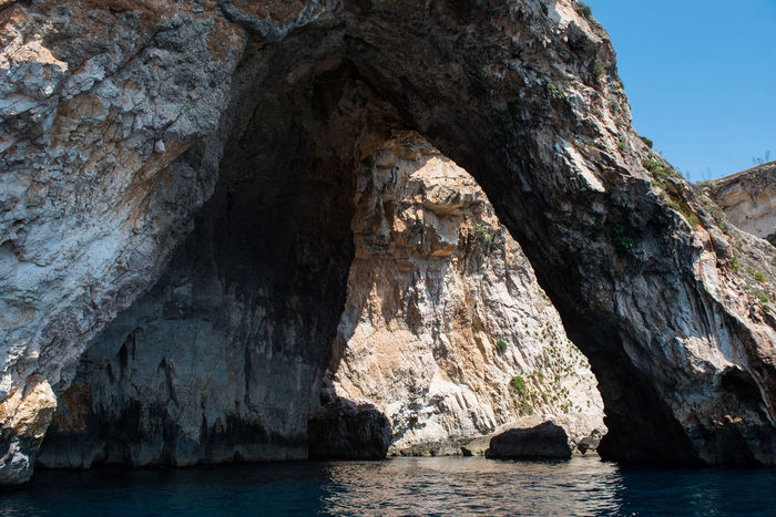 Gigantic sea caves. Blue grotto, Malta Blue Grotto Blue Grotto Cave Entrance Exploring Limestone Cave Malta Natural Arch Arch Beauty In Nature Boat Trip Cave Cavern Caves Day Grotto Gulf Limestone Littoral Littoral Cave Nature Scenics Sea Sea Cave Sea Water Tranquility