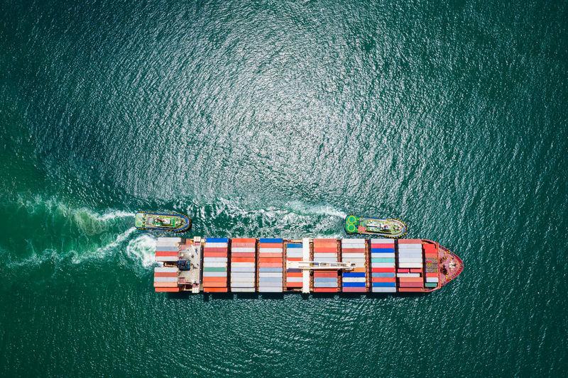 Container ship sailing the ocean, business cargo logistics