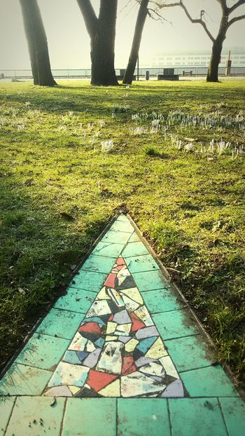 triangle Art is Everywhere Art Up Your Life Beauty In Nature Riverside Springiscoming Nearly Spring Mosaic Art Day Outdoors No People Tree Grass Nature Sky