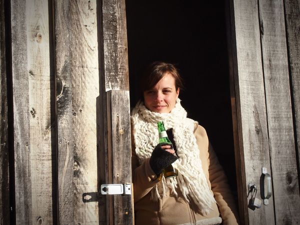 Always Be Cozy Woman Beautiful Beer Warm Clothing Cold Outside Rustic Barn Scarf Brown Hair Holding A Drink Glass Bottle Sunlight Warm Glow Reflective Pretty Pretty Woman Sun Light Sun On My Face  Smile Gazing Cozy Baby Its Cold Outside