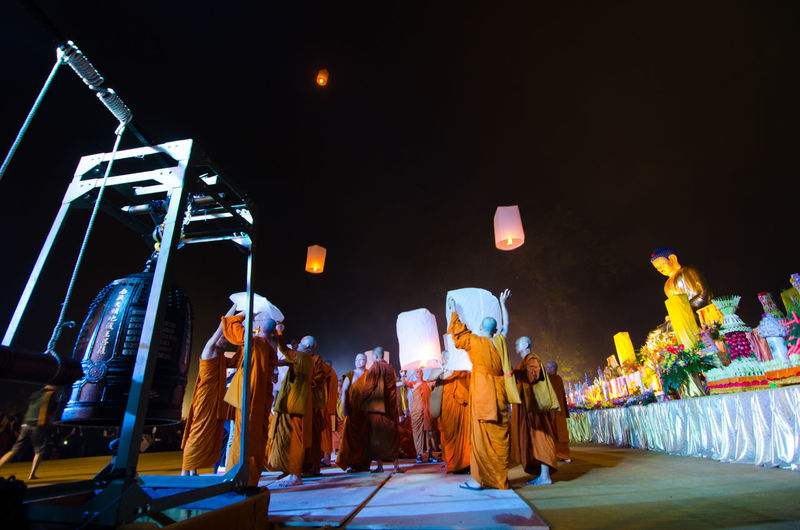 15 may 2014, Magelang, Indonesia : Participants releasing lanterns over the Borobudur temple in Magelang, Central Java during Vesak/Waisak Day celebrations Amusement Park Arts Culture And Entertainment Crowd Enjoyment Group Group Of People Illuminated Indoors  Light Lighting Equipment Men Night People Performance Real People Stage Stage - Performance Space Women