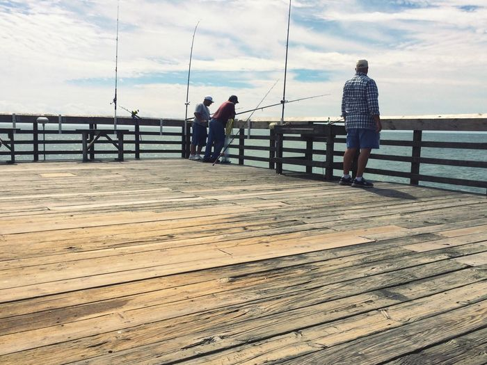 Fishing Fishing Pier People Ocean Sky Sky And Clouds Wood Blue Clouds And Sky