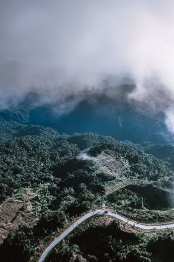 High angle view of road on mountain during foggy weather
