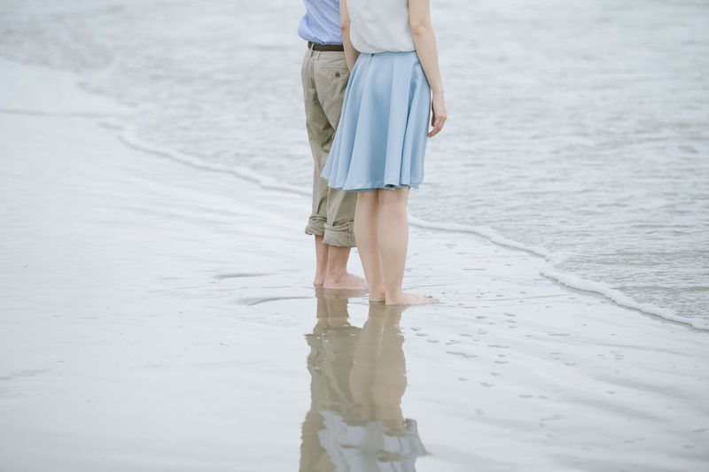 Real People Women Water Leisure Activity Lifestyles Low Section Nature barefoot Stand Up Standing On The Beach Beach Sea Romantic Travel Destinations Couple - Relationship Love Waves, Ocean, Nature Reflections In The Water Footpath Feetselfie Waves Crashing Sky Asian  Valentine Dating Togetherness Together Together Forever