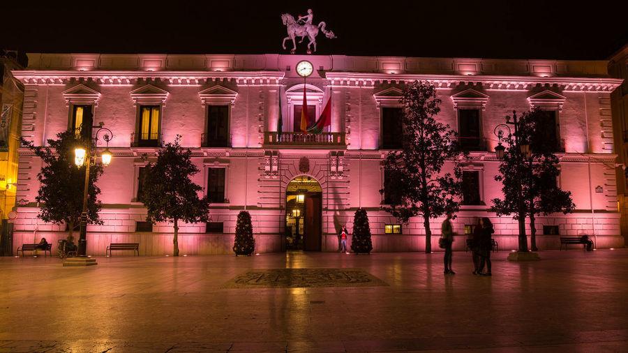 lit building at