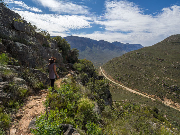 Rear view of woman walking cederberg wilderness mountain area, south africa