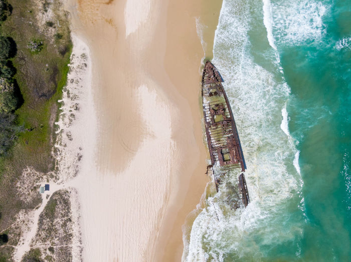 Aerial view of shipwreck on beach