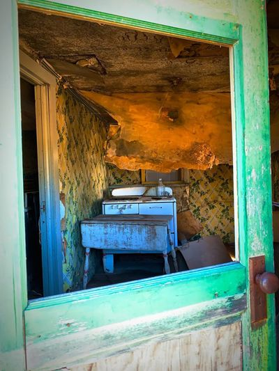 """""""Into The Past"""" A partially opened door, step into the past, a kitchen where family gathered, thinking it would last. Now all that's left are tattered walls, broken dreams down empty halls. The story there, may never be told, or why they left ever unfold, but ghosts may linger real or implied to keep one guessing about how it died. New Mexico Photography New Mexico Poetry In Pictures Poetry & Photography Language Poetry Broken Dreams Mystery Abandoned & Derelict Abandoned Buildings Old Buildings Old Houses Abandoned No People Old Architecture Damaged Weathered House Deterioration Ruined"""