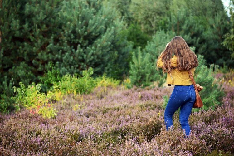 Green Jeans Leather Wanderer Wanderlust Field Forest Hair Heather Land Leather Jacket Long Hair Nature One Person Outdoors Puprle Flower Tree Women Young Adult