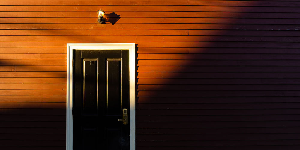 Early morning sunshine on a colorful home Architecture Built Structure Building Exterior Sunlight Shadow Building Day Door Entrance Wall - Building Feature Closed Pattern Outdoors Wood - Material Light And Shadow Colors Colorful Morning House Minimalism Vintage Red Yellow Lamp Frame