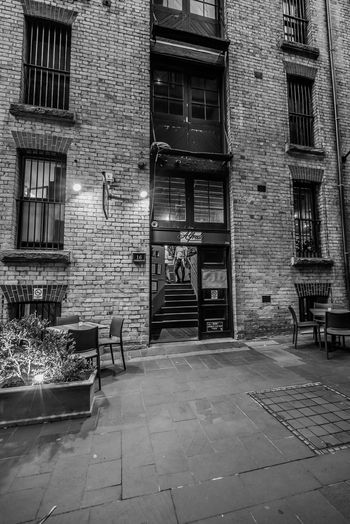 Alley Architecture Brick Wall Building Building Exterior Built Structure City Cobblestone Day House No People Outdoors Residential Building Residential Structure Sidewalk Street Sunlight The Way Forward Wall - Building Feature Window