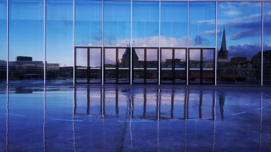 The city of Aarhus, reflected in the windows and the rain of DOKK1 and Aarhus Central library. Showcase: December Reflections Water Reflection Window Windows Window Reflections Dokk1 Aarhus Central Library Aarhus Denmark