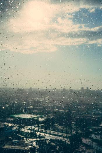 Full frame shot of wet window in city