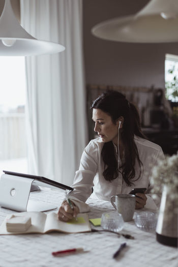 Woman working on table