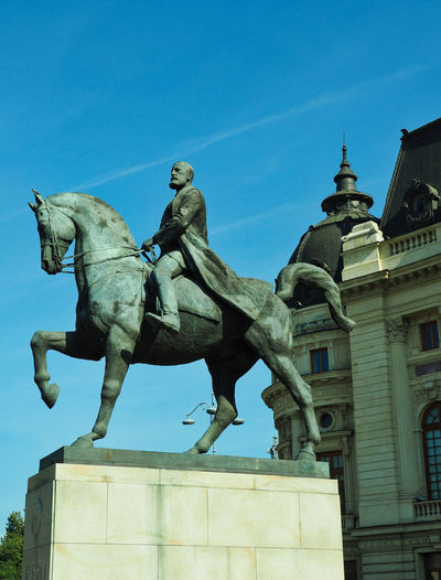 Statues Sculpture Statue Representation Architecture Human Representation Low Angle View Sky Male Likeness Built Structure Horse Building Exterior No People Outdoors History The Past Travel Photography Bucharest Bucharest, Romania Eastern Europe