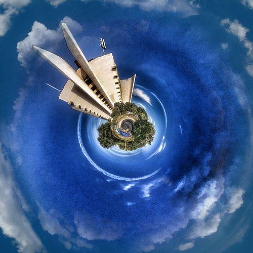 Digital composite image of airplane against sky
